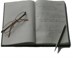 Notebook, pen and spectacles
